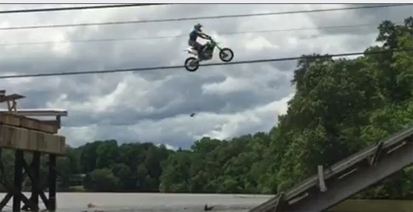 Cops Hunt Dirt Bikers Who Jumped Collapsed Bridge In Evel Knievel-Style Stunt