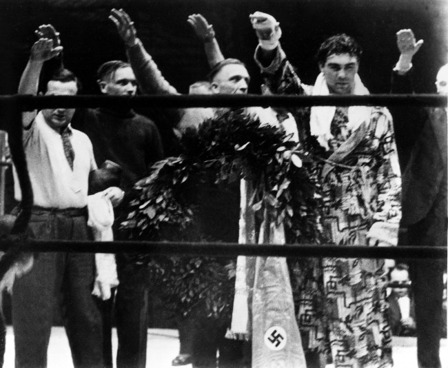 Max Schmeling 1931 World Heavyweight Champion - Max Schmeling, right, and his attendants give the Nazi salute in Hamburg, Germany, March 10, 1935. (Associated Press)