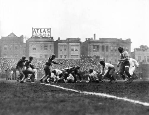 Wrigley at 100: Chicago Bears - The Chicago Bears recover their quarterback's fumble and go on to win the first scheduled NFL Football Championship game over the New York Giants at Wrigley Field by a score of 23-21 on Dec. 17, 1933. (Chicago Tribune / Getty Images)