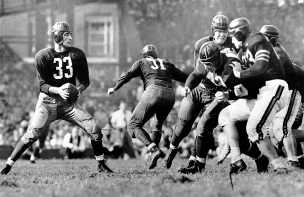 1942 - Sammy Baugh drops back to pass against the Bears in 1942 (AP)