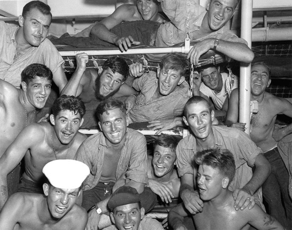 Photo Number: 80-G-343608 - Surrender of Japan, 1945 / Crew members on USS Wileman (DE-22) celebrate upon hearing of Japan's acceptance of surrender terms, August 15, 1945. (Official U.S. Navy Photograph, National Archives)